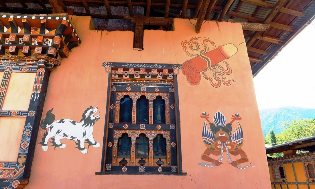 Images of phallus and demon the the wall of a home in Bhutan