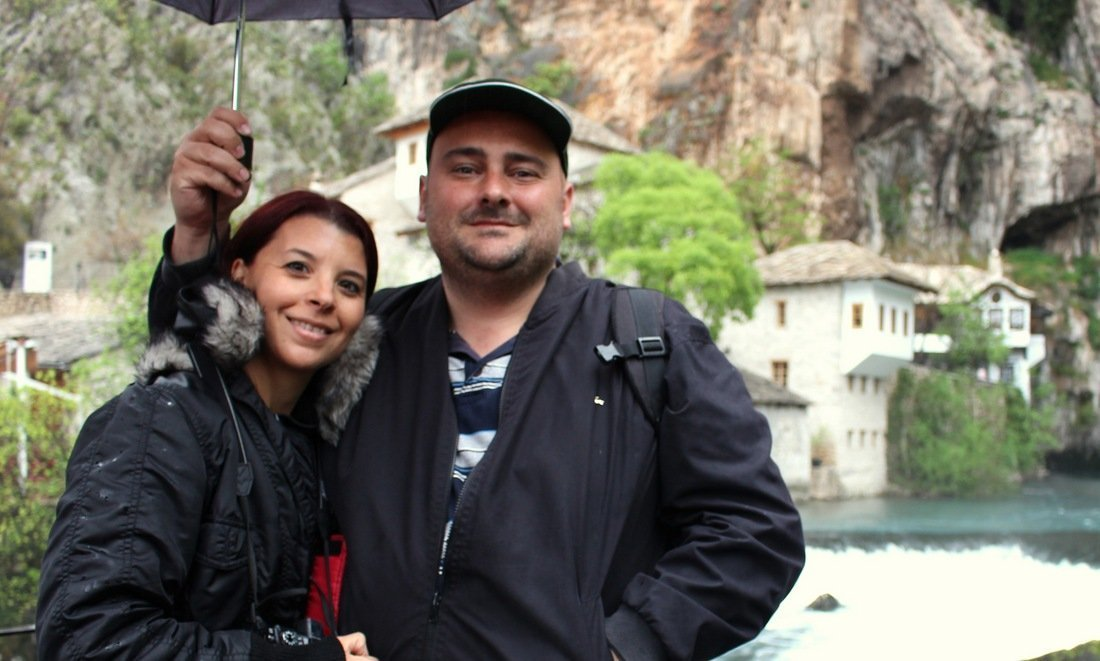 Michelle and Nikki in the rain under an umbrella in Blagaj, close to Mostar