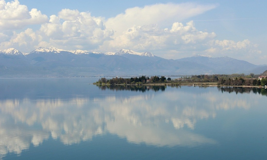 Lake Ohrid surrounded by snow topped mountains, views from the lake of Sveti Jovan