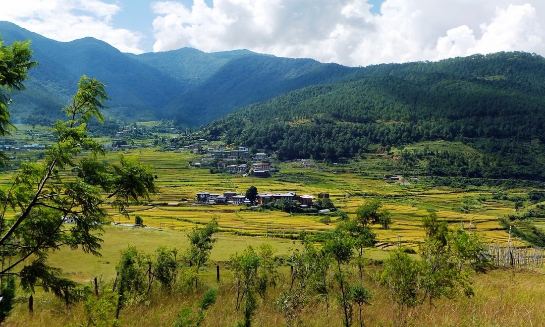 A beautiful valley surrounded by hills and mountains in Bhutan