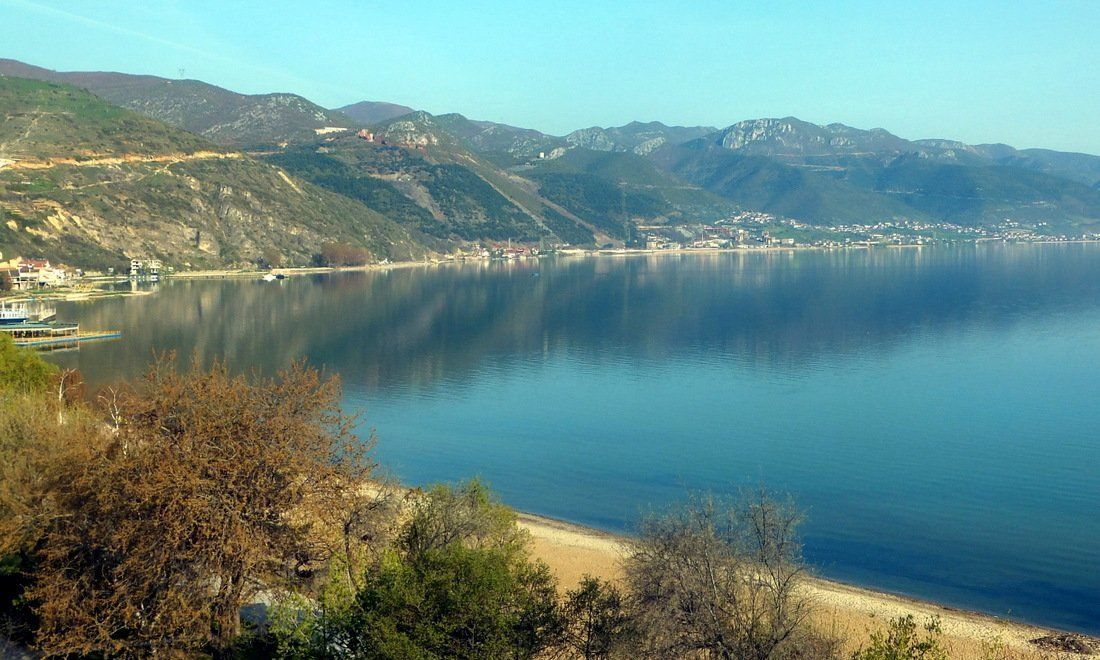 A view of Lake Ohrid surrounded by mountains in Albania - Albania travel guide