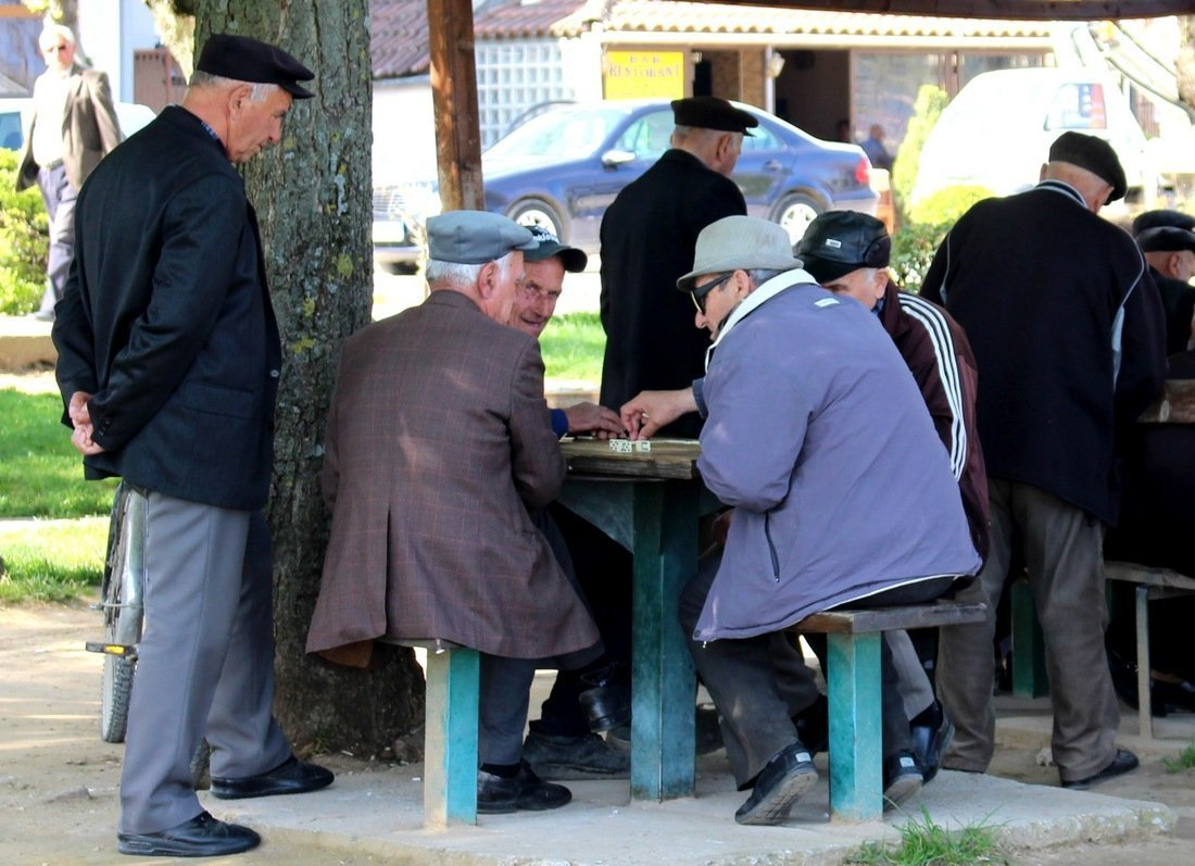 Local men playing dominos in Pogradec, Albania