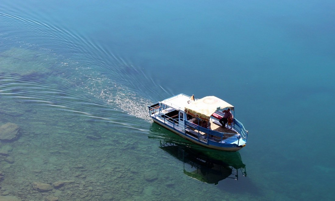 A passenger boat on Lake Ohrid, views from the lake of Sveti Jovan