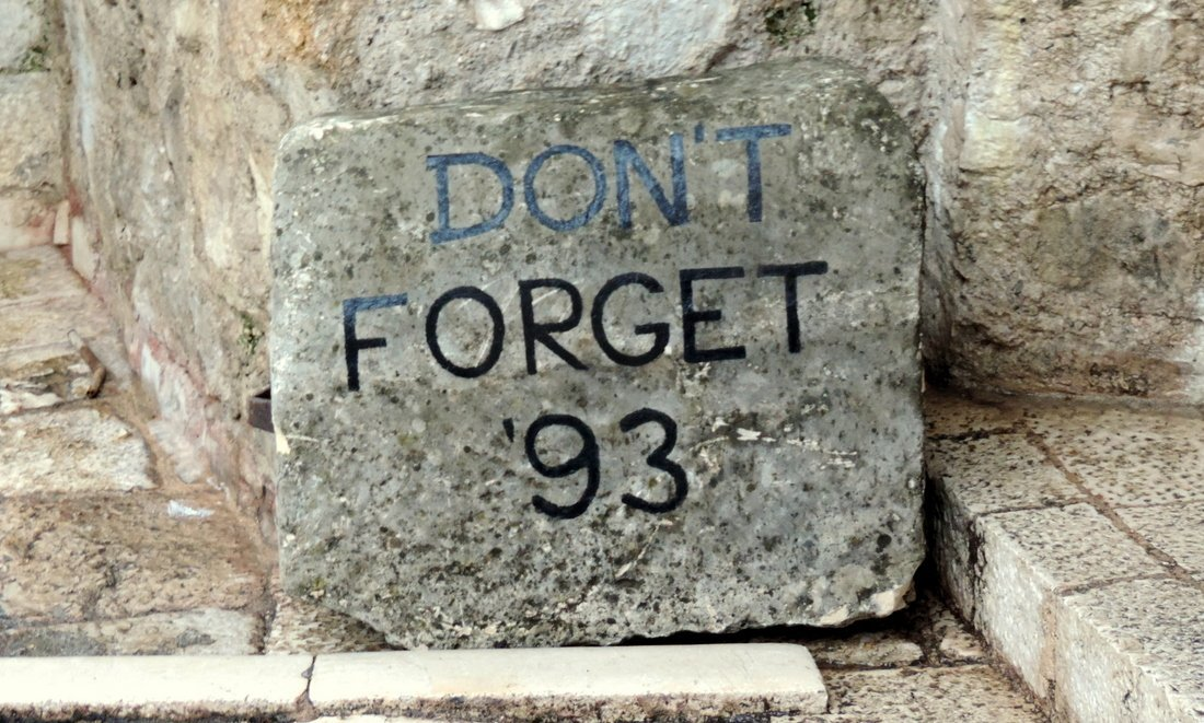A memorial stone showing the words Don't forget '93, Mostar