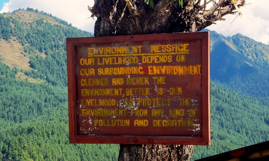 A billboard with an evvironmental message in Bhutan