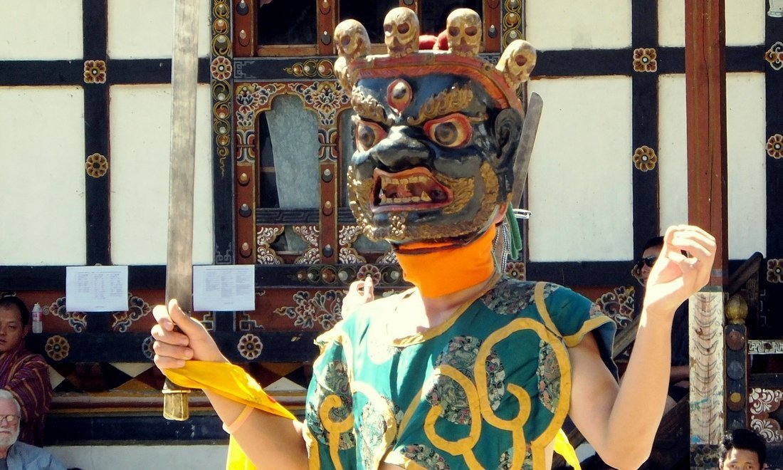 A masked dancer at a festival in Bhutan