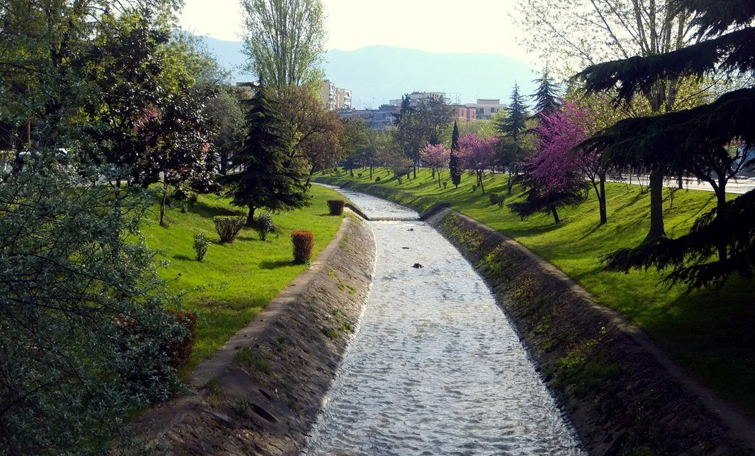 a stream crossing a park in Albania's capital, Tirana
