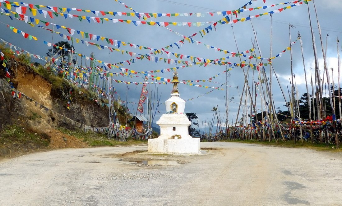 Prayer flags at the Yotong La pass during out road trip around places to visit in bhutan