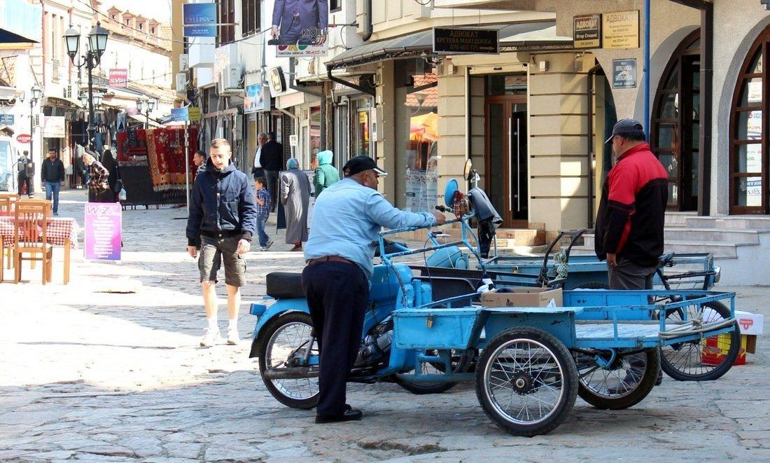 people walking in the old bazaar area in Skopje