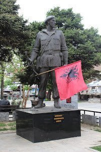 Guerilla fighter holding Albanian flag