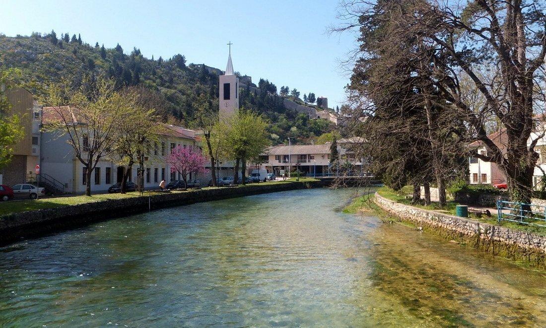 A river runs through Stolac, a quiet town in in southern Bosnia