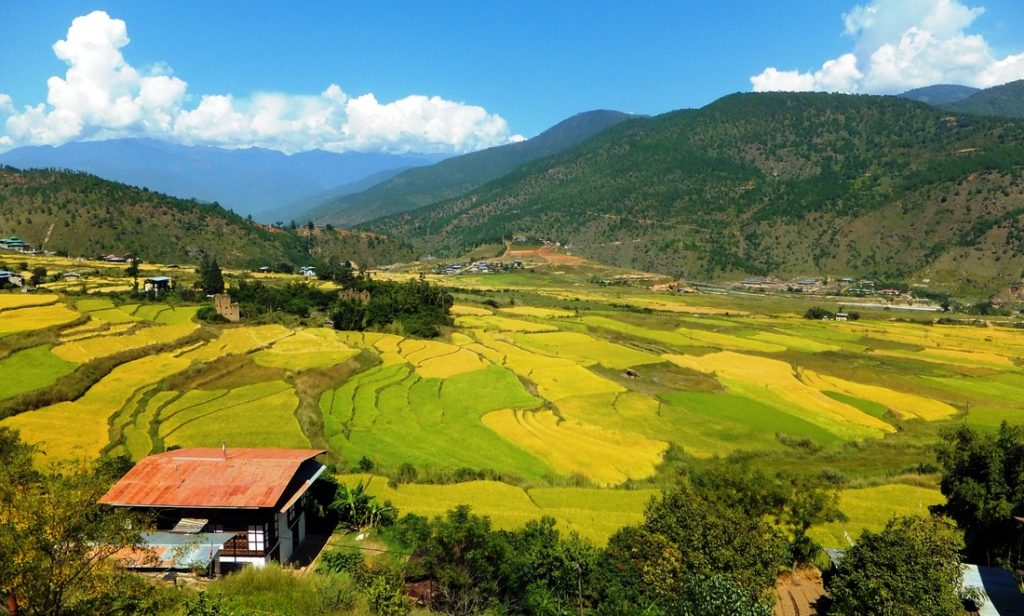 A view over a valley in Bhutan surrounded by mountains - travel to Bhutan