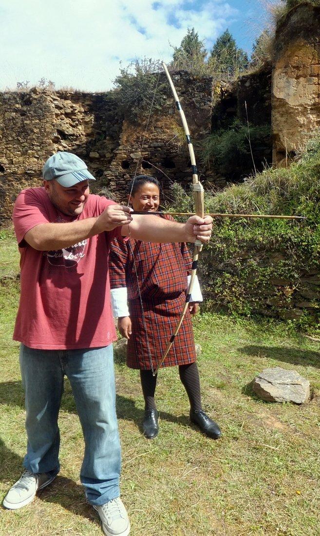Nikki practicing his archery skills in Bhutan