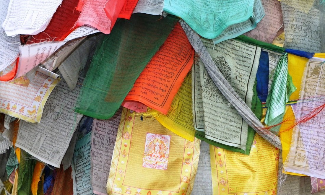 Colourful prayer flags in Bhutan - Sustainable tourism in Bhutan