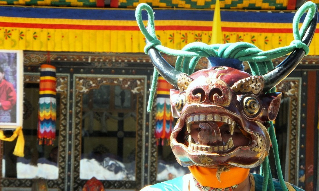 A masked dancer at the a festival in the Bumthang region of Bhutan - places to visit in bhutan