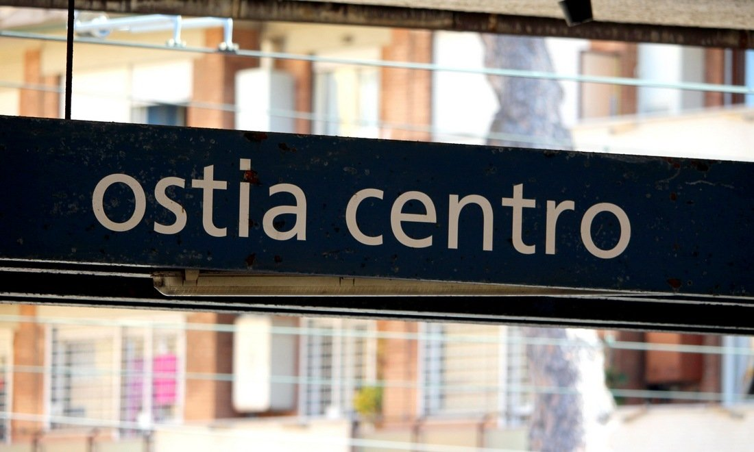 A sign saying Ostia Centro