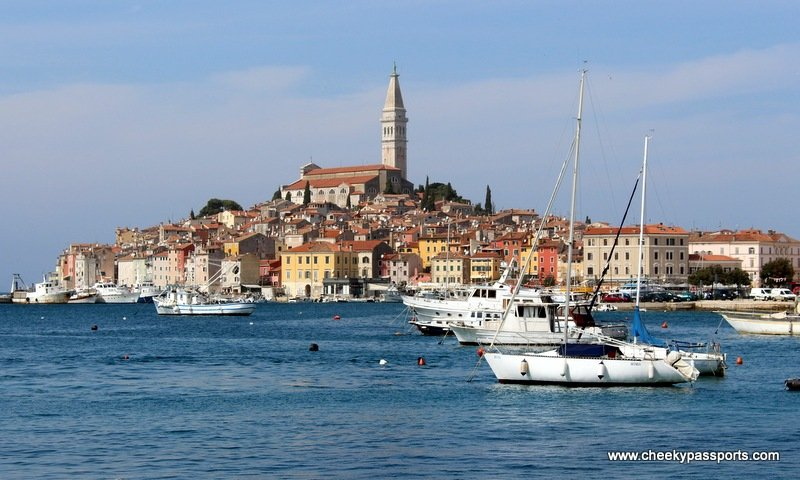 A fishing village of Rovinj surrounded by water and sailing boats - trip to Croatia