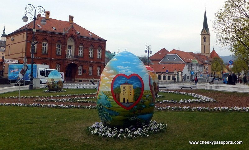 a giant painted easter egg in front of the cathedral