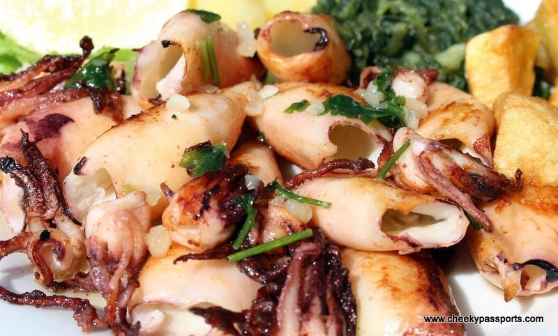 A dish of grilled calamari accompanied by potatoes - traditional Croatian food