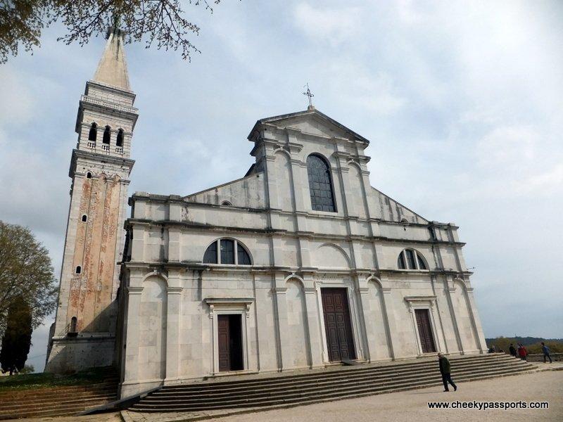 A man walking towards the Church of St. Euphemia in Rovinj one of the more popular towns in Croatia - a trip to Croatia