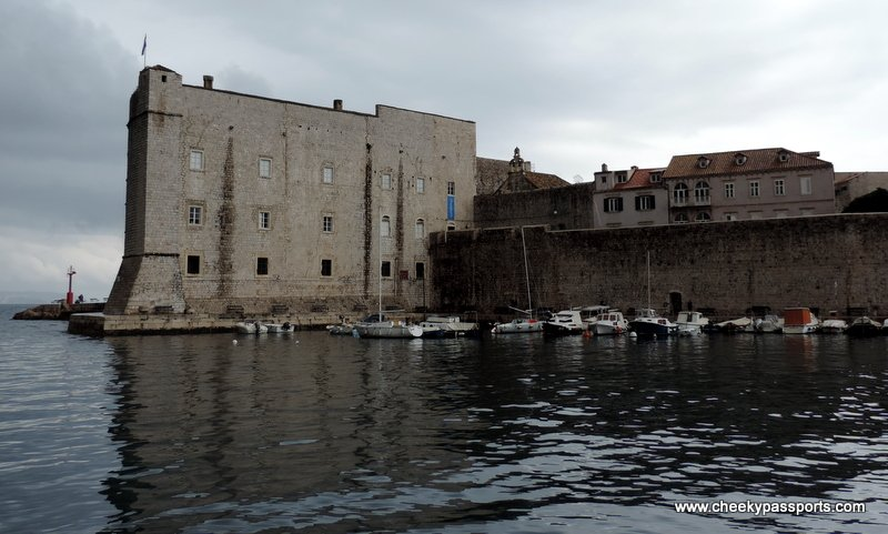The told town walls of Dubrovnik surrounded by sea - trip to Croatia