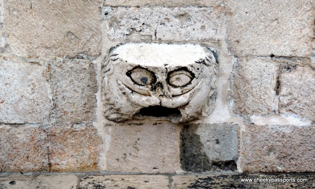 a gargoyle on which people try to stand without falling