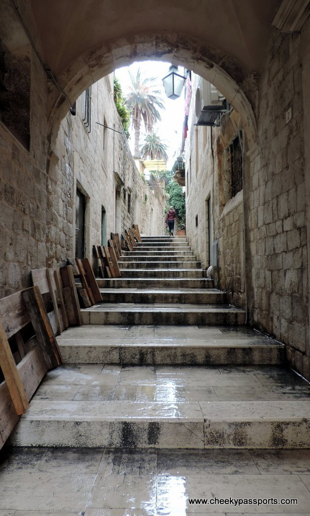 an empty lane with steps leading to the old town walls seen during our Dubrovnik visit
