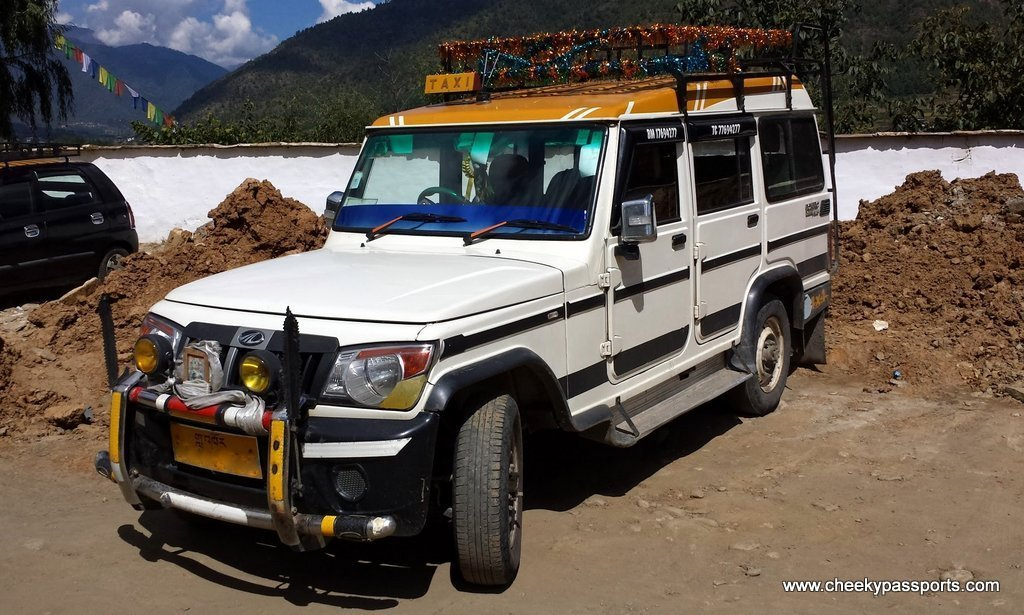 a brightly coloured 4x4 vehicle , planning a road trip