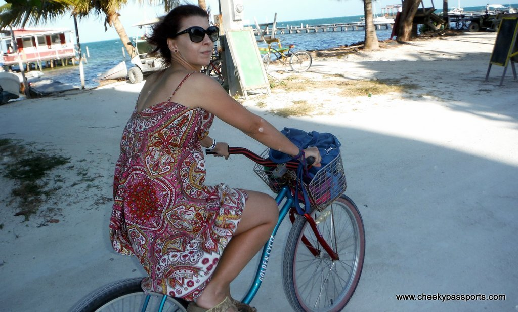 Michelle riding a bicycle in caye caulker, a different form of planning a road trip
