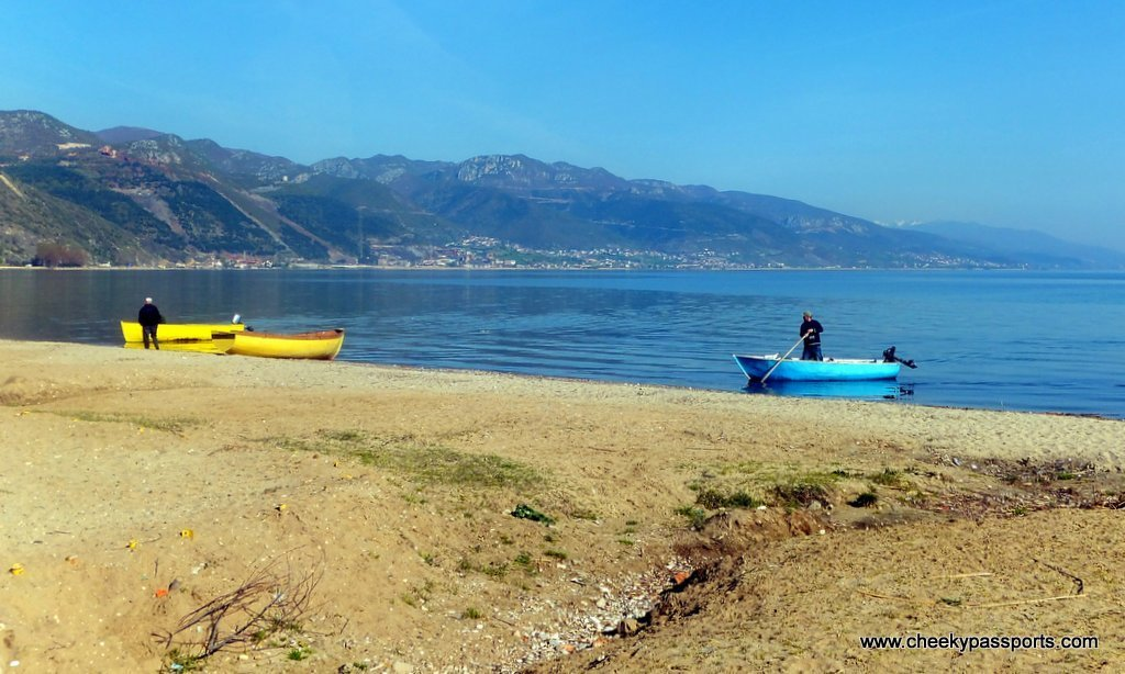 Men tending to their fishing boats on the shores of Lake Ohrid, Pogradec