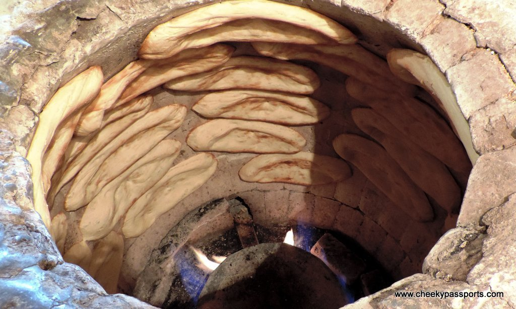 Bread baking in a clay oven - food in Georgia, Europe
