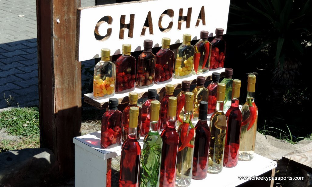 Different bottles of chilli and fruit chachas - food in Georgia, Europe