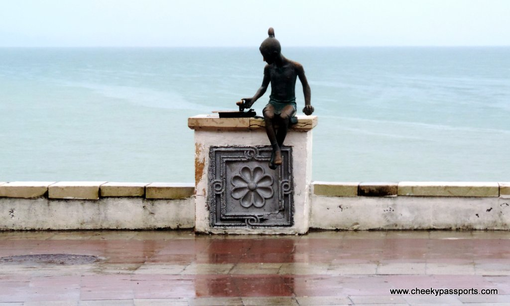 A statue of a little girl on the Sukhim riviera - visa to Abkhazia