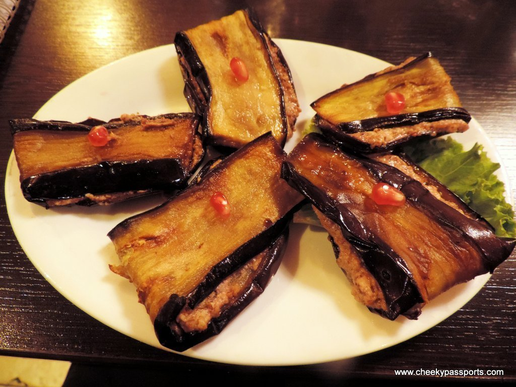 Grilled eggplant slices stuffed with a walnut sauce