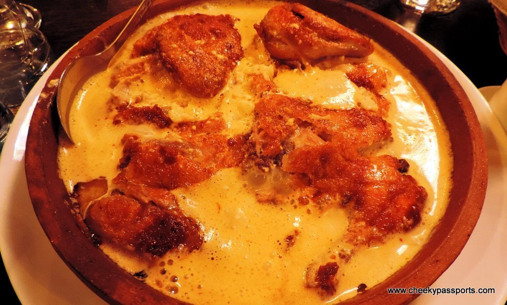 A stew of chicken cooked in a garlic milk sauce