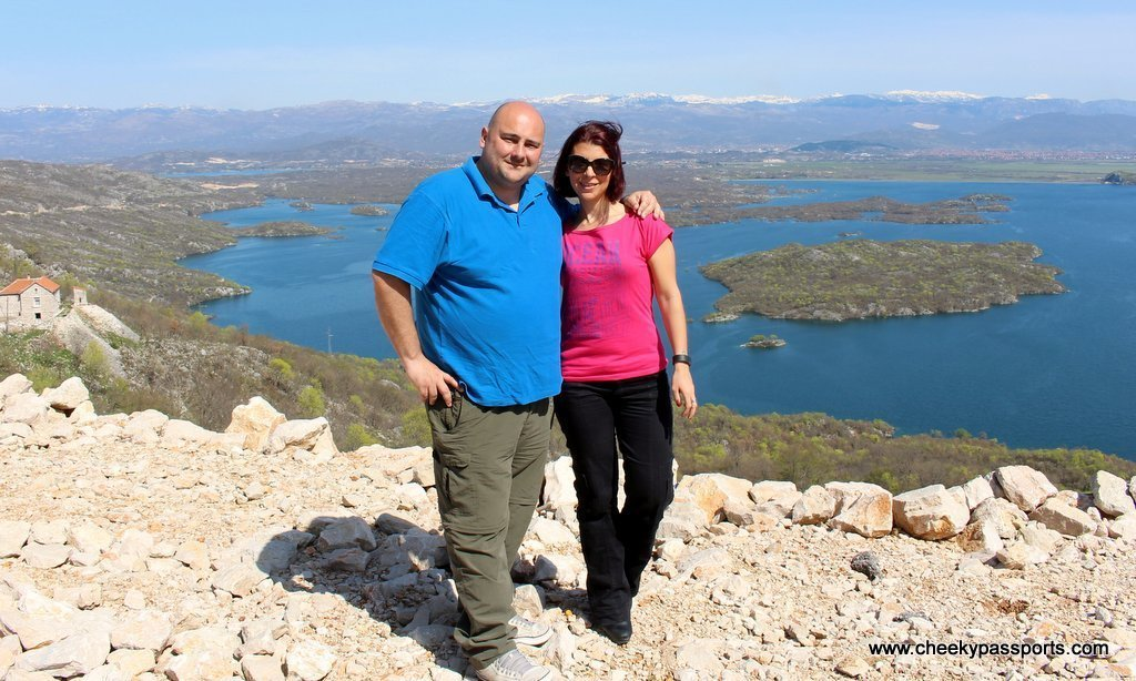 Nikki and Michelle with a beautiful view of a lake and islands and Niksic in the distance - what a  way of discovering montenegro