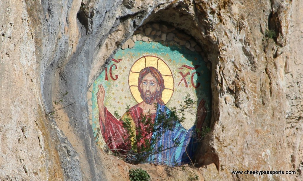 An image of Jesus Christ painted on the cliff face
