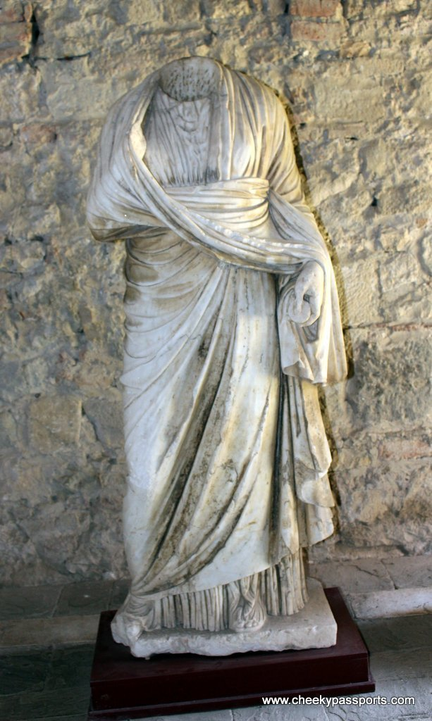 A headless statue of a robed woman inside one of the rooms - A Picnic in ancient Apollonia albania