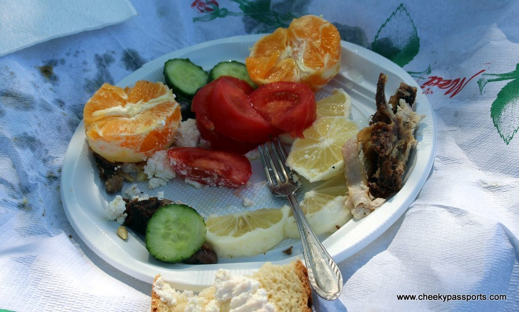 A plastic plate of fresh fruit and homemade food - A Picnic in ancient Apollonia Albania