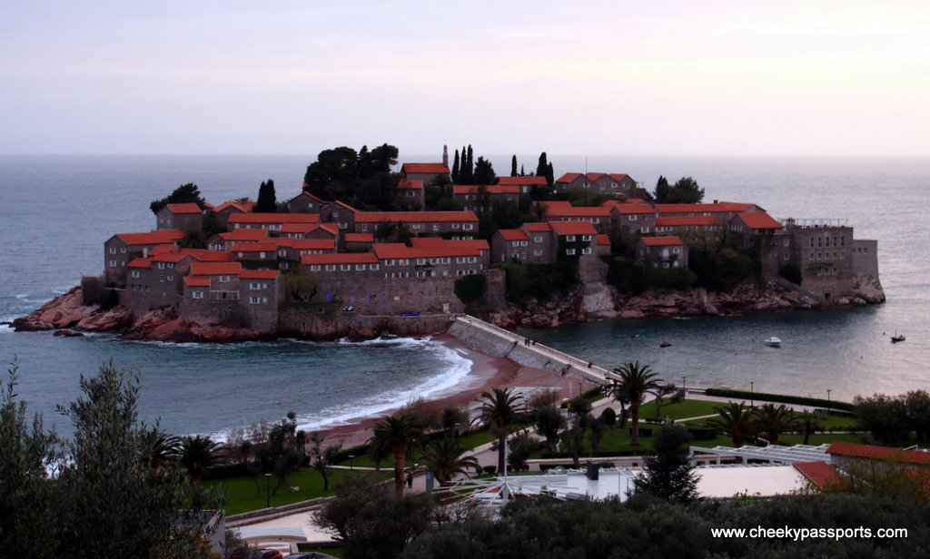 Sveti Stefan separated from the mainland by a sand bar - a top reason to visit Montenegro