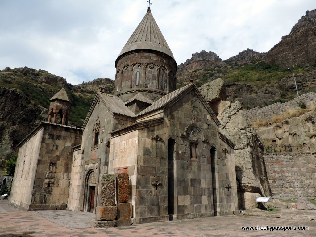 One of the churches at Geghard monastery surrounded by cliffs, amongst the top places to visit in Armenia