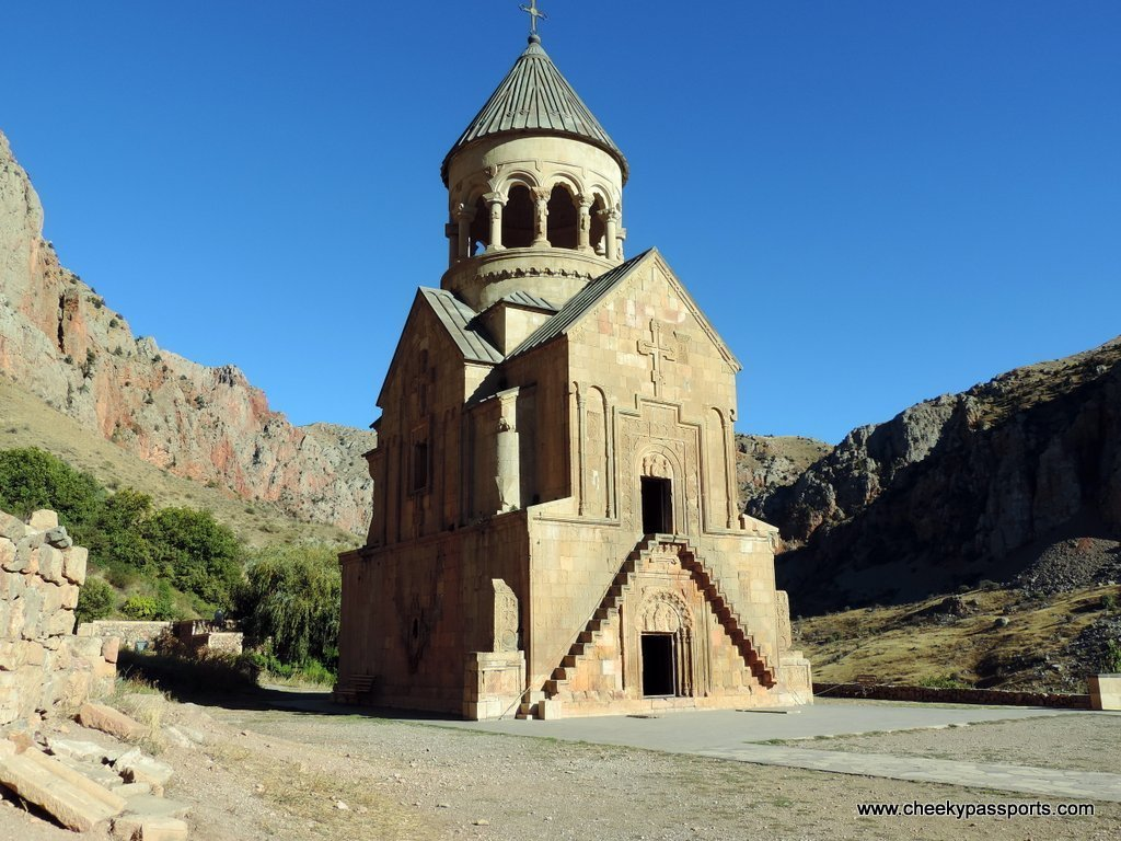 One of the churches with the Noravank monastery complex surrounded by red cliffs
