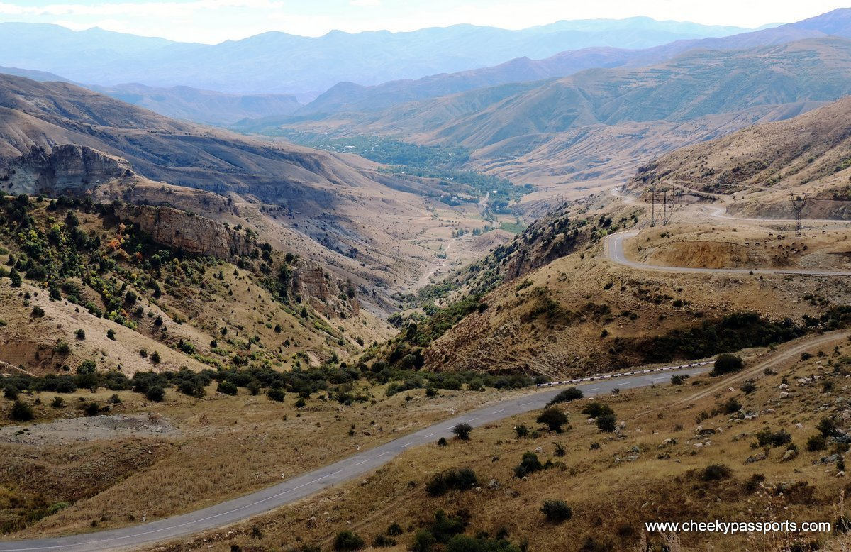 A scenic road cuts through valleys and mountains, amongst the top places to visit in Armenia