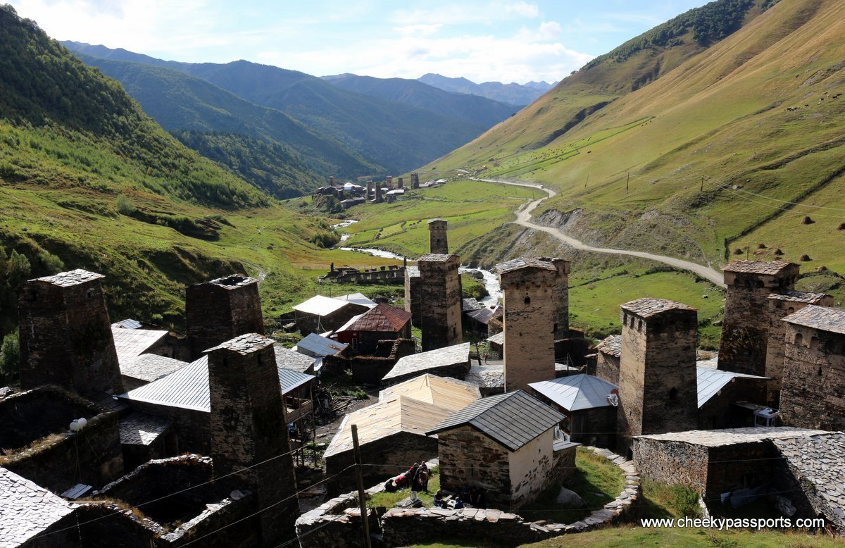 The Svan towers of Ushguli overlooking a meadow and a river - things to do in georgia, europe