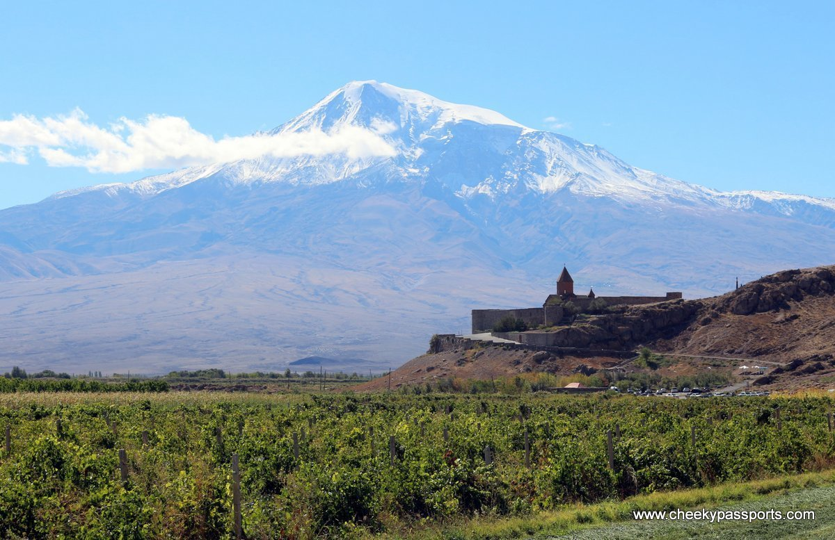 The monastery of Khor Virap sits at the foot of a snow-topped mount Ararat surrounded by fields, amongst the top places to visit in Armenia