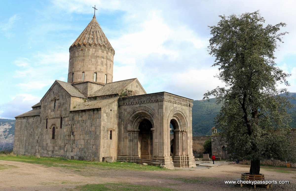 Tatev Monastery sits at the edge of a cliff overlooking a deep canyon (monasteries in Armenia)