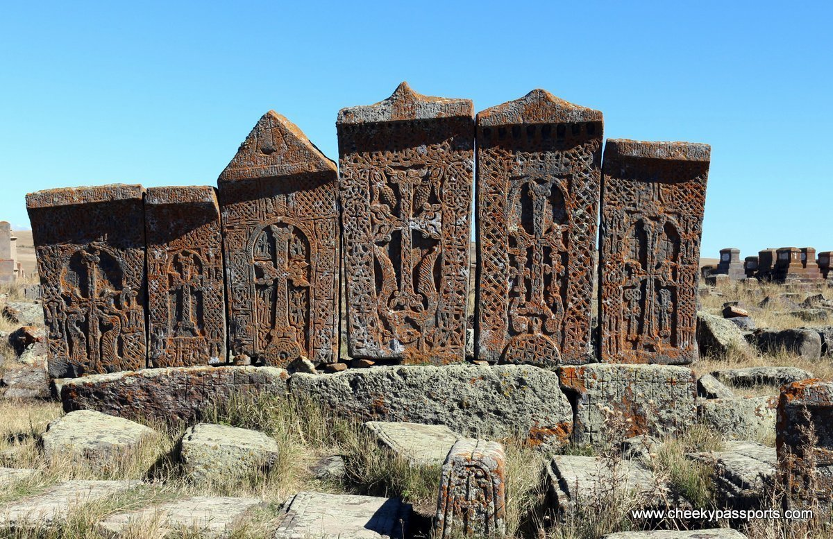 A group of Khachkars, intrictaely carved with crosses stand inside Noratus cemetery - monasteries in Armenia
