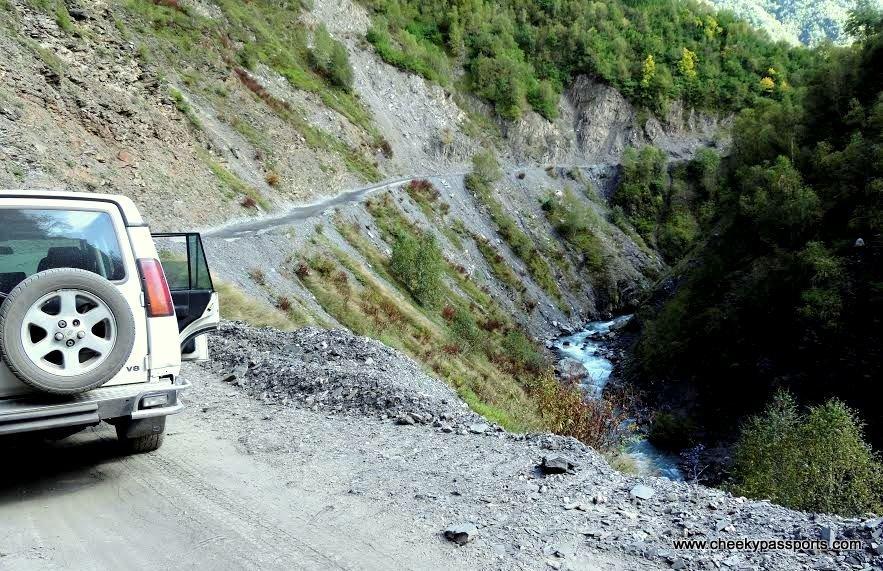 our vehicle on a narrow mountain ledge