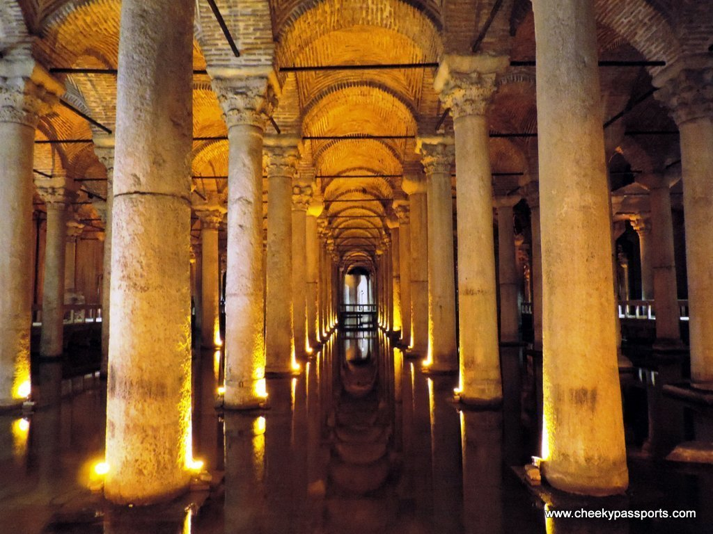 The beautiful dark interior of the basilica cistern , to visit during a layover in Istanbul