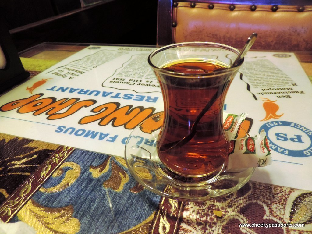 A glass of Turkish Caj at an Istanbul restaurant to visit during a layover in istanbul
